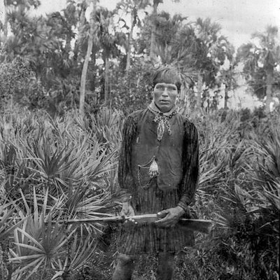 Photograph of Charlie Cypress, Seminole, in the Everglades. Taken 1900.