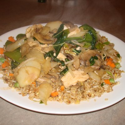 Garlic chicken and peapods chop suey with fried rice.