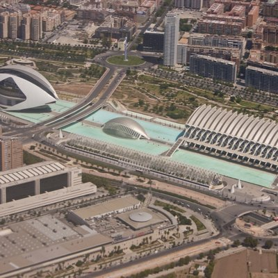 An aerial image taken from a Boeing 737 on the EMA to VLC flight path of The Ciutat de les Arts i les Ciències (Valencian), Ciudad de las Artes y las Ciencias (Spanish) or City of Arts and Sciences. The buildings are situated in the Turia Gardens, a dry river bed of the now diverted River Turia in Valencia, Spain. The image depicts: El Palau de les Arts Reina Sofía (opera house and performing arts centre), L'Hemisfèric (Imax Cinema, Planetarium and Laserium), L'Umbracle (walkway / Garden) and El Museu de les Ciències Príncipe Felipe (science museum). Taken using Canon 300D, ISO 100, 55mm (18-55mm), f/8, 1/1500 sec