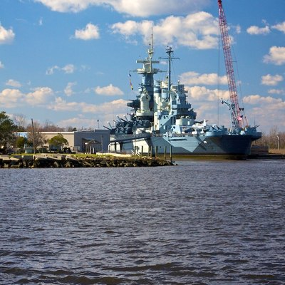 Photograph Taken From The Wilmington Riverwalk Of The Battleship Uss North Carolina.