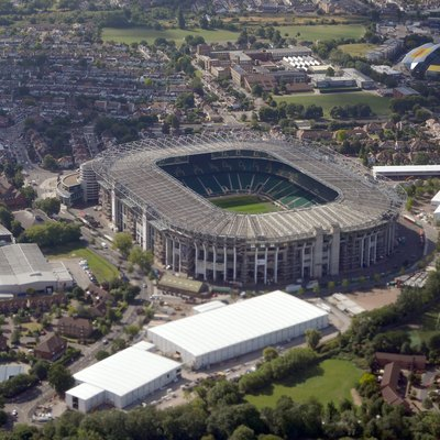 Aerial view of Twickenham Stadium (centre) and Stoop Stadium (background) from the north in August 2015.