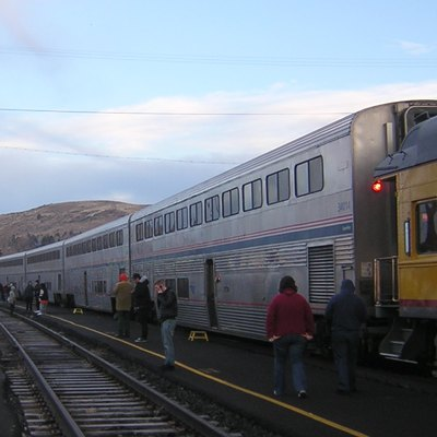 Amtrak Coast Starlight (Train #14) Makes A Service Stop In Klamath Falls, Oregon. Several Private Cars, Empty, Are Pulled Behind The Superliner Coaches.