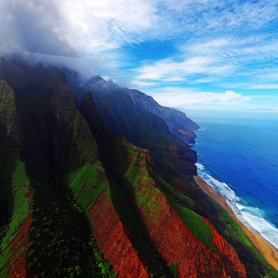 Aerial view of the coast of Nā Pali Coast State Park in Kauai, Hawaii with the photo's color saturation cranked way up.