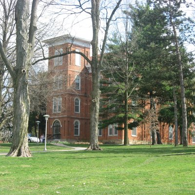 Grounds of Wilmington College, including College Hall. Photo is taken just southeast of the intersection of College Street with Fife and Rombach Avenues (U.S. Route 22/State Route 3) in Wilmington, Ohio, United States. Built in 1866 and the oldest building on the campus, College Hall is listed on the National Register of Historic Places.