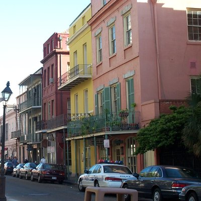 Colorful homes in New Orleans, 2001, from Conti Street, looking riverwards from Royal Street. Entrance to Exchange Alley is just past the yellow building.