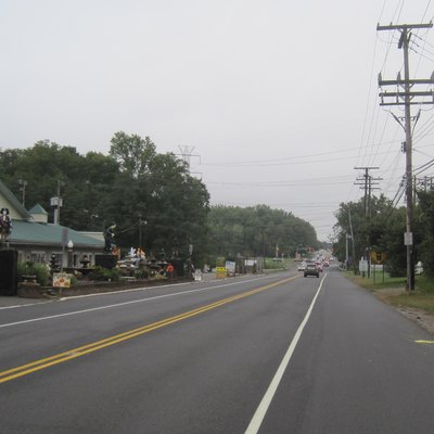 Photograph showing the center of Colts Neck, New Jersey (the unincorporated settlement and the township of the same name). Photo taken along southbound New Jersey Route 34 approaching County Route 537.
