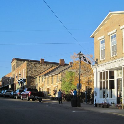 A view of Commerce Street in Mineral Point Historic District. St Perran's flags fly from the hotel and café in the foreground.