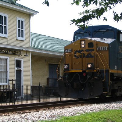 The Conyers Depot, now the Conyers Welcome Center, still sees trains running in front of it. Photo taken by Steve Karg