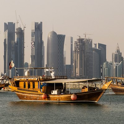 Traditional dhows in front of the West Bay skyline as seen from the Corniche, in Doha, Qatar.