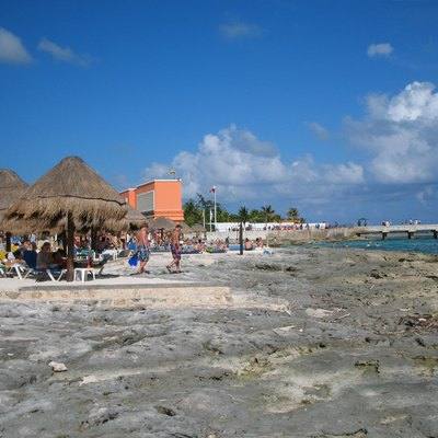 A photograph of the beach near Costa Maya, Mexico, looking toward the pier where cruise ships dock. Taken by NormanEinstein, January 3, 2006 at Costa Maya, Mexico.