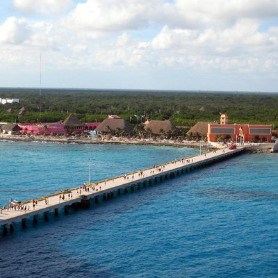 This photograph of Costa Maya, Mexico, was taken from the Carnival Victory cruiseship docked at the end of the resort's pier. The image was taken in January 2006, and shows the entire resort area, including the administration building, several bars, swimming pool, beach, and shops selling ubiquitous souvenirs. The nearby village of Mahahual is off the left of the image. Both the resort and the pier would be destroyed by Category 5 hurricane Dean's passage through the Yucatan in 2007, though they both were rebuilt. Taken by NormanEinstein, January 3, 2006 at Costa Maya, Mexico.