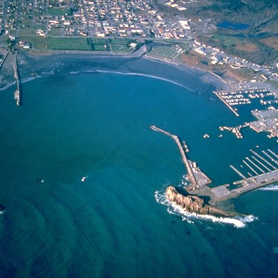 Aerial view of the breakwaters and harbor at Crescent City, Del Norte County, Califiornia, USA. View is to the north-northwest.
