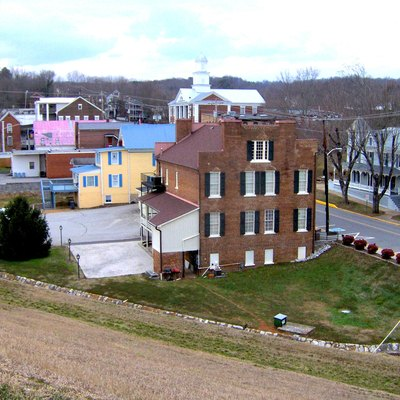 Dandridge, Tennessee, in the southeastern United States. This view of the historic district is from atop the earthen dam that protects that town from Douglas Lake overflows. The historic district includes the courthouse, built in 1845, the Gass General Store building (now Smoky's Steak & BBQ), built in 1826, the town hall, visitor's center, and a cemetery containing the burials of several Revolutionary War veterans.
