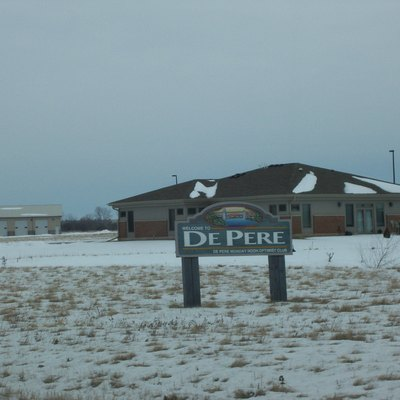 The welcome sign for De Pere, Wisconsin, USA. Travelly northbound on Wisconsin Highway 57. Taken February 11, 2007 by myself.