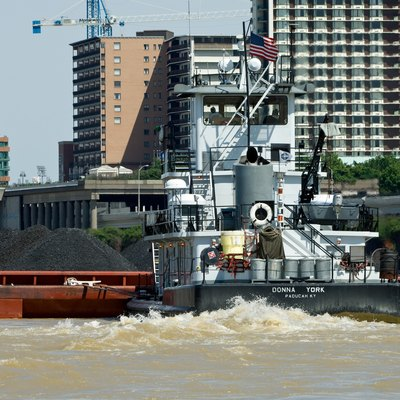 The towboat, Donna York, pushing barges of coal up the Ohio river. The tow had just exited the Portland canal at Louisville, Kentucky.