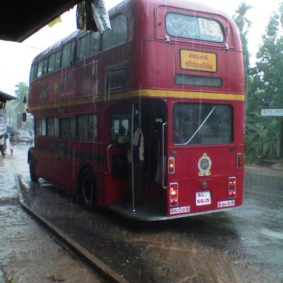 A double-decker bus plying in the 122 route from Maharagama to Avissawella, stopped at Godagama junction in Homagama, Sri Lanka.