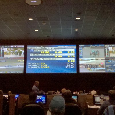 Dover Downs' sports lounge, showing the three main TV which are simulcasting different horse racing tracks