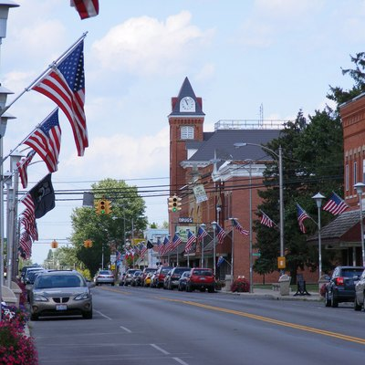 A look down Main Street in Bluffton, Ohio, including town hall and the American flags.