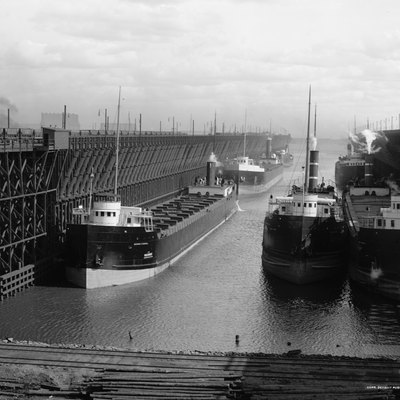 Ore docks of the Duluth, Missabe and Northern Railway loading ships in w:Duluth, Minnesota. (Ship left front is George H. Russel launched 1905 in Ecorse, Michigan)