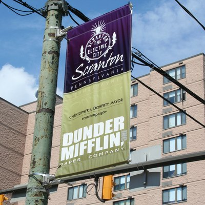 A banner promoting Dunder-Mifflin, the fictional paper company on NBC's