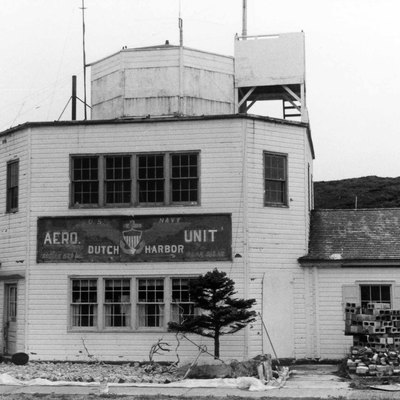 United States, Alaska, Dutch Harbor. The Building At The Airport Used As A Communication Room And Terminal, With The Old United States Navy Aero Unit Insignia In August 1972 Before The Restoration Years Later.