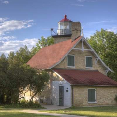 "This is a photo of the ""Eagle Bluff Lighthouse"" that was built in 1868. The Eagle Bluff Lighthouse is located in Peninsula State Park in Door County, Wisconsin. It was built on orders from President Andrew Johnson. Construction costs total $12,000."