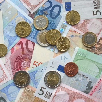 A Picture Of Some Euro Banknotes And Various Coins