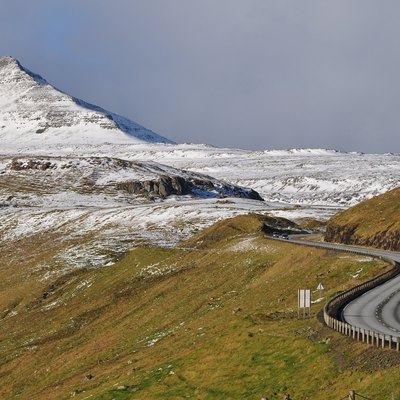 The road network on the Faroe Islands is excellent, considering the small numer of people living there. Six of the main islands are connected by tunnels, bridges and dams. Shown is the road from Skipanes to Syđrugøta on the island Eysturoy.