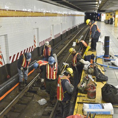 Eight hundred workers from MTA New York City Transit performed critical maintenance tasks on the A, C and E subway lines each night from April 23-27, 2012. Workers were able to replace rails and cross ties and scrape track floors, thereby removing muck and debris. In subway stations, paintable areas not reachable during normal train operation were scraped, primed and painted. Maintenance crews also took the opportunity to clean lighting fixtures, change bulbs and repair platform edges while performing high-intensity station cleaning. These photos show a small sample of what they did. Photo: Metropolitan Transportation Authority / Patrick Cashin.