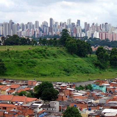 Slums on the outskirts of a wealthy urban area in São Paulo, Brazil is an example of inequality common in Latin America.