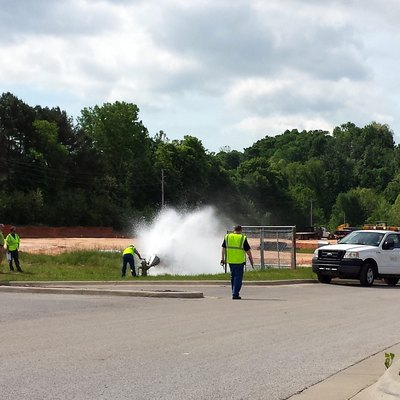 City of Fayetteville Water/Sewer Operations Staff flushes a fire hydrant in Uptown Fayetteville