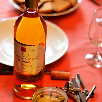 A terrine of foie gras with a bottle of Sauternes.