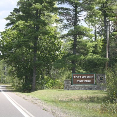 Entrance sign for Fort Wilkins Historic State Park, on U.S. Route 41 in upper in Michigan.