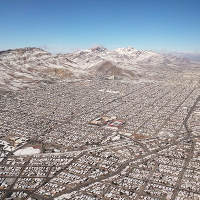 The Franklin Mountains with snow from winter storm Goliath, Dec. 28 2015; El Paso, Texas, neighborhoods around Austin High School (center) are shown, from central El Paso at the bottom to Northeast El Paso at the top. The Patriot Freeway (aka the North-South Freeway), US highway 54, is on the right.