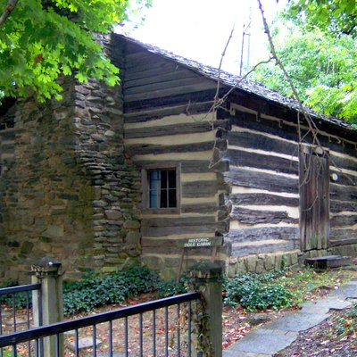 The William and Martha Jane Huskey Ogle Cabin in Gatlinburg, Tennessee, constructed ca. 1807. The cabin is now located on the Arrowmont campus, next to the Arrowcraft Shop. A plaque on the cabin's west wall reads: