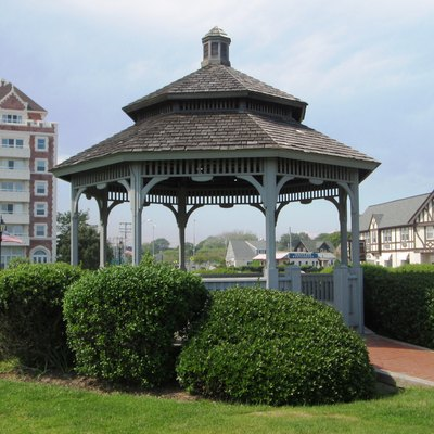 The gazebo on The Plaza in Montauk, New York, Behind it are buildings in the Tudor Revival style connected to Carl G. Fisher's failed attempt to turn Montauk into the Miami Beach of the north; the 6-story building to the left is The Tower at Montauk, a residential condominium.