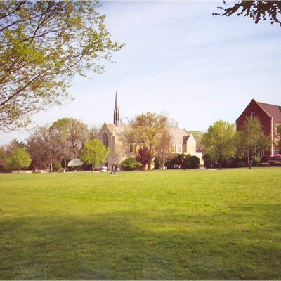 The quad of Grove City College in May 2005, with Harbison Chapel, opened in 1930, on the left, and North Hall, a women's dormitory, on the right.