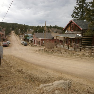 This is looking west down the main street in Gold Hill. The intersection in the foreground is Boulder Street and the Sunshine Canyon road.