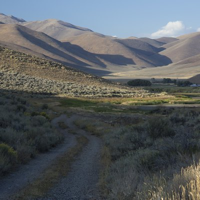 Goodale's Cutoff of the Oregon Trail at Lava Lake, west of Arco, ID and east of Carey, ID along US 26, 20, 93. Picture of current two track along section of the cutoff of the Oregon Trail.
