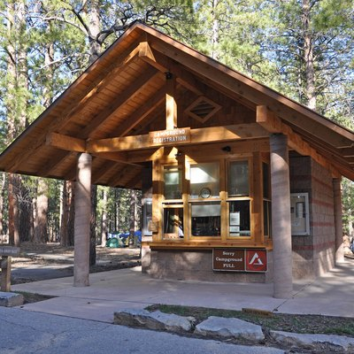 The North Rim Campground is open from mid-May to mid-October. Operated by the National Park Service... There are no hook-ups, however, there is a dump station within the campground. Pets are allowed, but must be leashed at all times, and may not be left unattended. Wood and charcoal fires are only permitted in provided campsite grills. No gathering of down wood - wood may be purchased at the general store. Coin operated laundry and showers are located at the entrance to the campground. Accessible campsites and restrooms are available.. . Reservations may be made through the National Recreation Reservation Service by calling. 1-877-444-6777 or online at www.recreation.gov/ It is possible to check at the campground for the slight chance of an availability. Campsites are $18-$25. Golden Age or Access passport holders pay only ½ price year round (passport number is needed when making reservation and passport holder must be camping at the site). A maximum of two vehicles, six people, three tents are allowed per site. (A vehicle, which is towing a trailer, pop-up, tent trailer, fifth wheel, or a motor home pulling a vehicle, is considered two vehicles.). . After mid-October, weather permitting, a limited number of campsites at the North Rim Campground with limited services (portable toilets) will be available on a first-come, first-served basis until snow closes Highway 67. Hikers and cross-country skiers will be permitted to use the park's group campsites throughout the winter months if they have obtained a permit through the park's Backcountry Information Center.