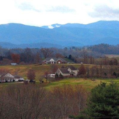 Rural Greene County, Tennessee, with the Bald Mountains (part of the Blue Ridge province) rising in the distance, viewed from the Andrew Johnson National Cemetery.