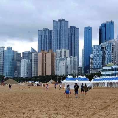 Panorama of Haeundae and Marine City on a Cloudy Day. Busan, South Korea. Photograph from Flickr; author Jinho Jung; license of cc by sa 2.0.