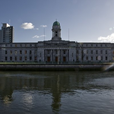 Cork City Hall in Cork, Ireland. The Elysian Tower, The Republic of Ireland's tallest building, can be seen in the background on the left.