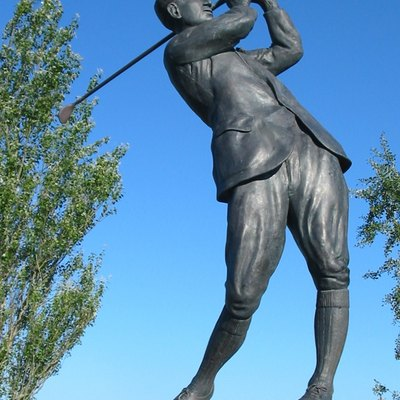 A statue of Jersey golfer, Harry Vardon, stands at the entrance to the Royal Jersey Golf Club