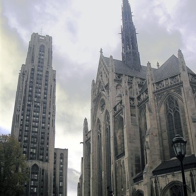 The Cathedral of Learning prior to its 2007 cleaning with Heinz Memorial Chapel at the University of Pittsburgh. photo by Michael G White