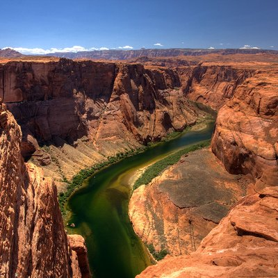 Horseshoe Bend Arizona. Horseshoe Bend is the name for a horseshoe-shaped meander of the Colorado River located near the town of Page, Arizona, in the United States. It is located slightly downstream from the Glen Canyon Dam.