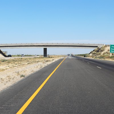 Interstate 5 northbound in the Central Valley. The section shown is at an overpass for an unnamed frontage road following the Buena Vista Canal in Kern County.