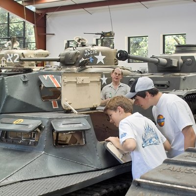 Jacques Littlefield shows some of his tanks to visiting students from the Woodside Priory School, May 2004.