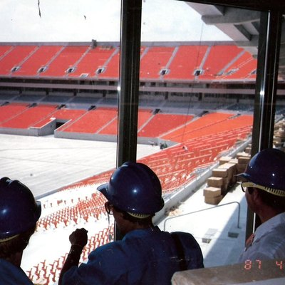 My mom back when she was a county official, checking out the new stadium where the field would eventually be placed.