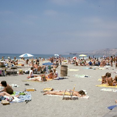 La Jolla Shores Beach (La Jolla, California) in July of 1978, showing festive crowds, Scripps Pier in the background